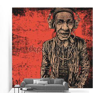 пожилой человек с наушниками, слушающими музыку