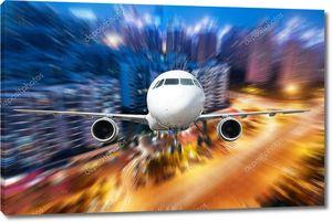 самолет вдали от города