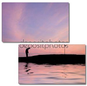 Силуэт гольфиста на фоне заката
