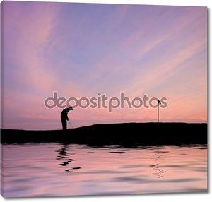 Гольфист силуэт против потрясающий закат небо