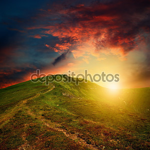 Amazing mountain sunset with red clouds