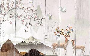 Олени с рогами из цветов на фоне гор