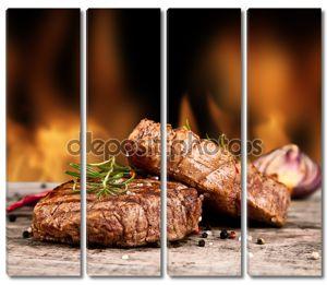 Говяжий стейк на фоне огня