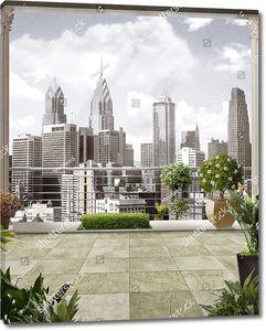 Вид сквозь колонны на современную архитектуру