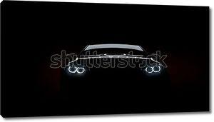 Черный автомобиль на мерном фоне