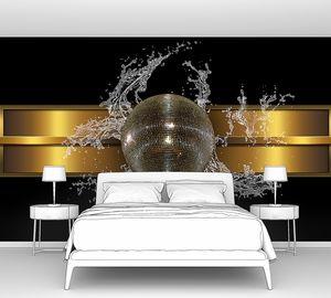 Блестящий шар на золотистой полосе с брызгами