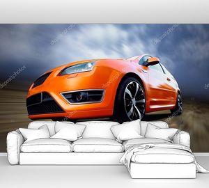 Красивый Оранжевый спортивный автомобиль на дороге