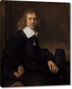 Рембрандт. Молодой человек сидит за столом