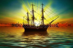 Парусная лодка на закате
