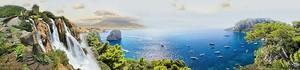 Вид сверху на водопад и море