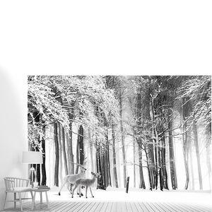 Пара оленей в зимнем лесу