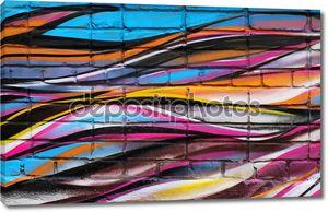 Уличный арт на кирпичной стене