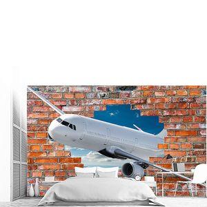 Самолет вылетает в пролом кирпичной стены