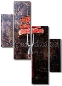 говяжий стейк на вилке