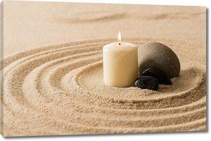 Свеча и камни на песке