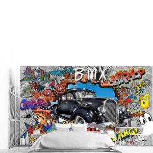 Ретро авто вырывается из кирпичной стены с граффити