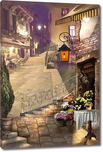 Улица города в фонарях в вечернее время