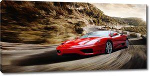 Красная спортивная машина очень быстро едет по горной дороге