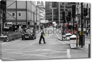 Police officer crossing street, London, England